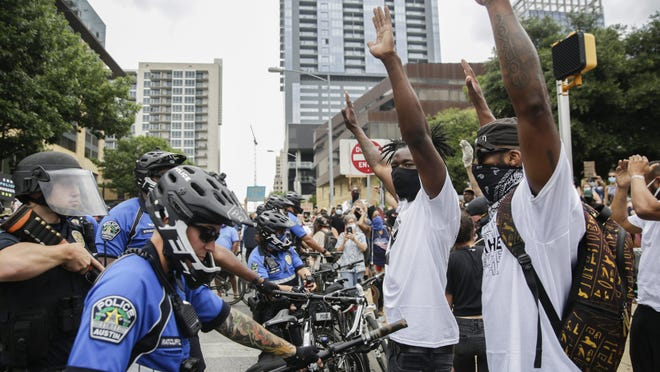 People gather by the thousands Sunday in Austin to protest against police violence, including the deaths of George Floyd in Minneapolis and Michael Ramos in Austin.