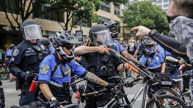 Austin police use bikes as protesters advance during a protest on May 31. Local bike shop Mellow Johnny's decided it no longer want to sell bikes to the Austin Police Department, but the city has asked it to stay on until the department can find a new vendor.