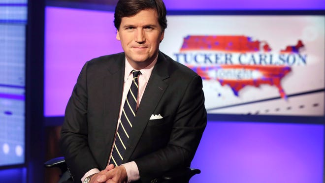 "In this March 2, 2017, photo Tucker Carlson, host of ""Tucker Carlson Tonight,"" poses for photos in a Fox News Channel studio, in New York."