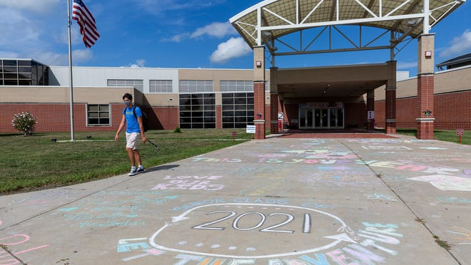 """Glenwood High School parents decorated the sidewalk with motivational messages for the seniors to see as they pick up their books and meet their teachers for the fall semester at the Glenwood High School, Friday, August 28, 2020, in Chatham, Ill. Glenwood High School will start the school year remotely as the Ball-Chatham board of education said it was """"operationally impossible to provide an equitable experience for high school students"""" as they tried to offer both hybrid and remote models because of the COVID-19 pandemic."""