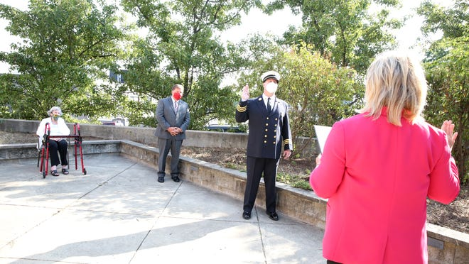 Joe Jackson Jr., Quincy's new fire chief, was sworn in at a private ceremony outside of his mother's nursing home. Lisa Aimola/City of Quincy