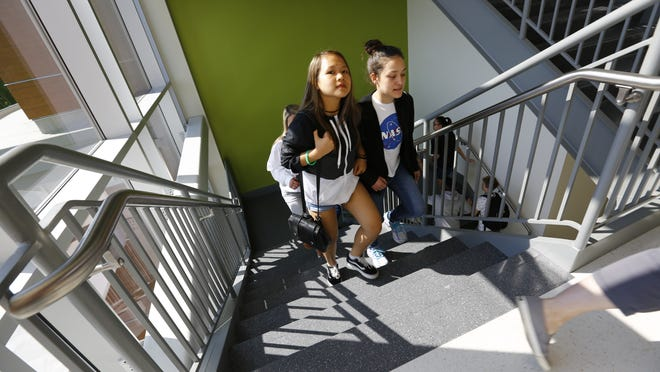 Students walk up a stairway in Sterling Middle School in West Quincy on Monday, June 3, 2019. Greg Derr/The Patriot Ledger