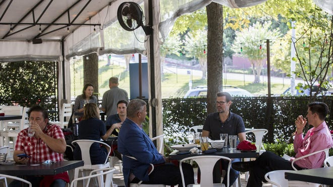 Customers were spaced apart last month in an outdoor dining section of Juliet Italian Kitchen off Barton Springs Road. New data indicates the Texas labor market may be improving amid the coronavirus-induced economic downturn.