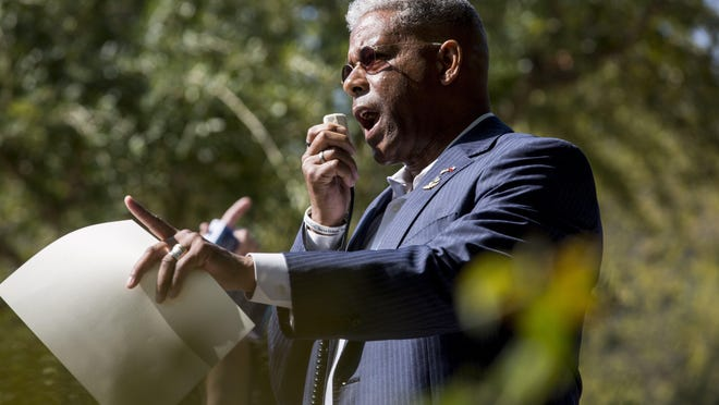 State Republican party chairman Allen West speaks to a crowd of over 100 people as they gather in protest against Greg Abbott's handling of the coronavirus pandemic on Thursday, Oct. 10, 2020. West said Monday that he would not support state Rep. Dade Phelan, R-Beaumont, in his bid for Texas House speaker.