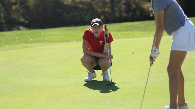 Concordia's Abby Donovan positioned herself for her first state high school golf championship Monday at the Class 4A state tournament at Emporia Municipal Golf Course. Donovan was the only player to break 80 and her 79 gives her a three-shot lead going into Tuesday's final round.