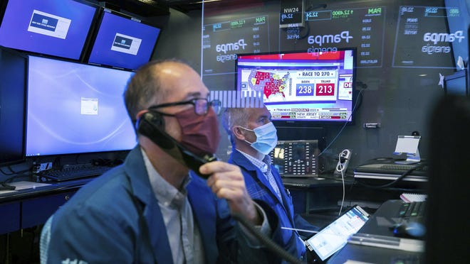 This photo provided by the New York Stock Exchange shows activity on the trading floor, Wednesday, Nov. 4, 2020. Stocks are rallying again on Wednesday, but only after spinning through an election night dominated by surprises and sharp swings.