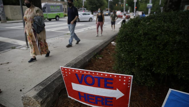 FILE - People wait in a line to vote in the Georgia's primary election at Park Tavern on Tuesday, June 9, 2020, in Atlanta.