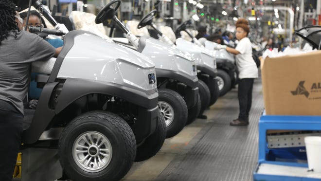 Club Car employees assemble the company's Onward golf car model at its manufacturing plant in Evans. The vehicle maker's parent company has announced all employees will be eligible for stock options.