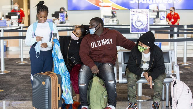 From left, Cadence Sterling, 9, Marlon Barnes, 16, his sister Marlaika, 19 and aunt Angie Dickens wait for their flight back to Cleveland, Ohio at Austin-Bergstrom International Airport in Austin on Tuesday.