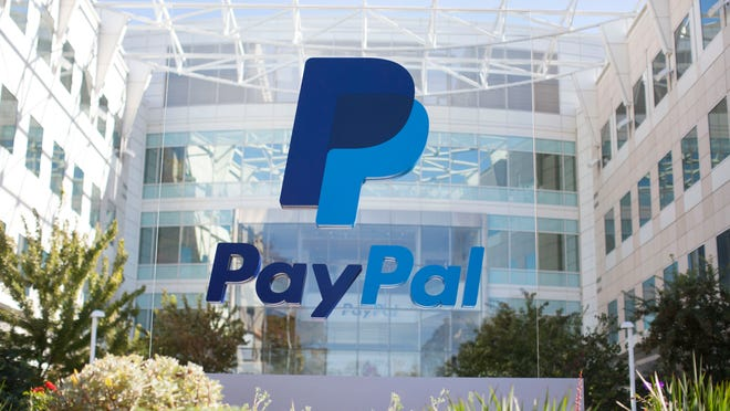 The PayPal logo is clearly displayed outside of the company's headquarter building.