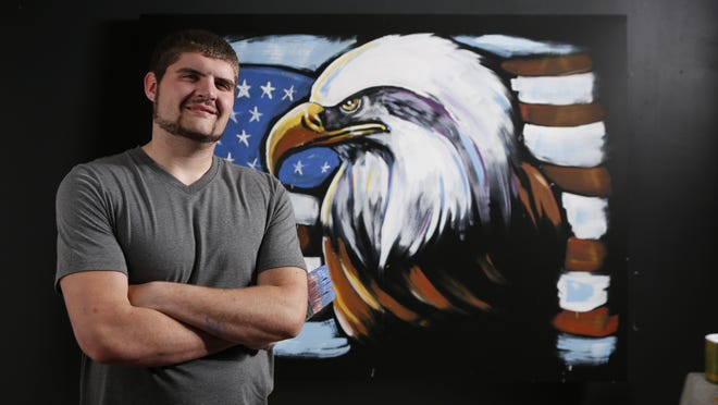 Spencer Nolan Young of Shiocton created this eagle painting in less than 12 minutes as part of a video shoot for an advertisement being shown on the big screen at Lambeau Field during Packers home games this season.
