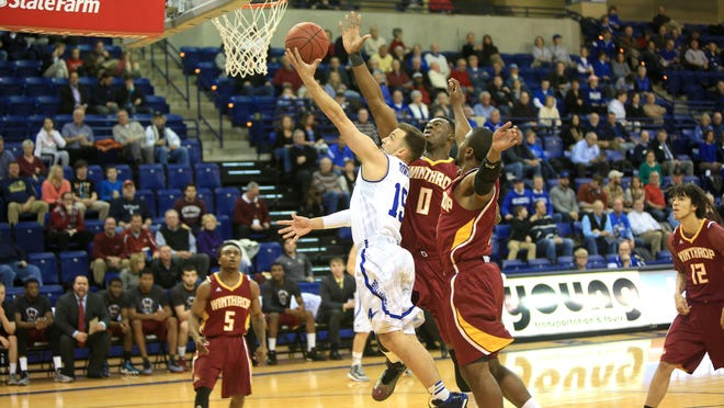 UNC Asheville's Andrew Rowsey shoots against Winthrop's Duby Okeke (0) during Wednesday night's game at UNCA.