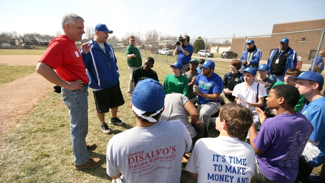 Bradney Ciminowasielewski, (2nd from left with hat) Winton Woods High baseball coach and his team thank Joe Motz, far left, after the Motz Corporation came together for a yearly community service project to renovate the baseball field at Winton Woods High School. Winton Woods received a makeover through a grant from The Motz Corporation and the Cincinnati Reds. A complete infield makeover, along with a new pitcher's mound and new drainage, new bases, and dugouts repainted.