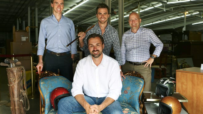 Brian Graves, seated, Jon Nielsen, back left, Andy Nielsen, and Mike Reynolds, partners of Everything But The House, an online personal property and estate sale company on Wilmer Avenue in Linwood. Photo shot Friday July 18, 2014. The Enquirer/Cara Owsley