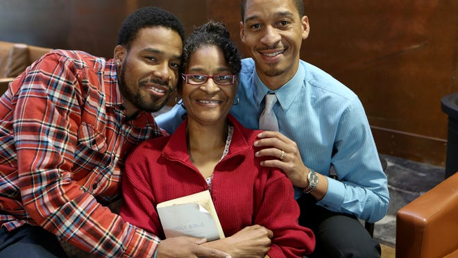 Deborah Pennington of Roselawn, with sons Romell Salone, left, and Deris Pennington, has spent the past 15 years rebuilding a life that was lost to drugs and crime. In spite of multiple college degrees, she can't find a decent job because of her record.