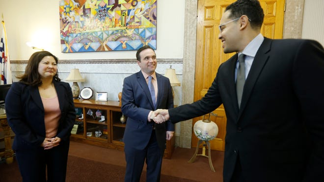 Mayor John Cranley meets with the two new hires announced Monday: Oscar Bodella, the new trade and development director, and Paula Boggs-Muething, the newly named city solicitor.