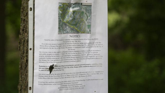 A paper posted along the Inner-Urban Trail serves as an eviction notice for those living at a homeless camp.