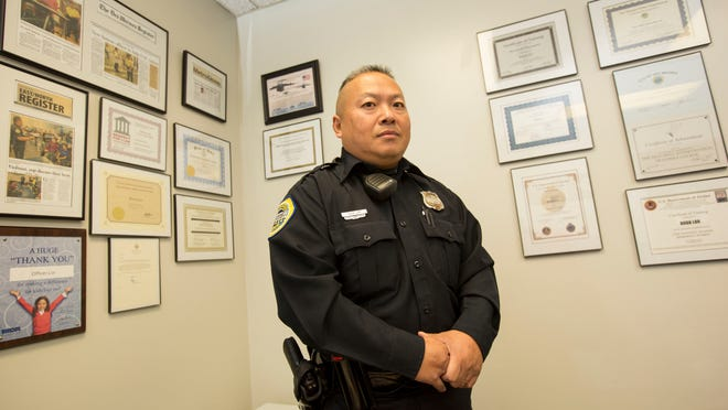 Officer Doua Lor is a Des Moines police officer who does interpreting with minority groups and is an Asian liaison between the police department and the Des Moines Asian population. In his office his work is celebrated on the walls.