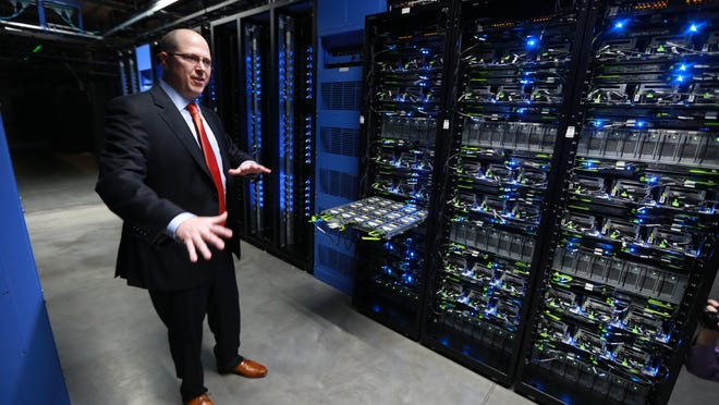Brice Towns, manager of the Facebook data center in Altoona, speaks during a tour of the Facebook data center in 2014.