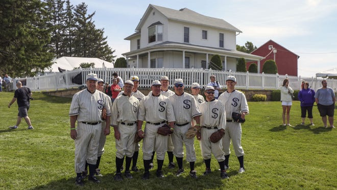 """Ghost players pose together for a picture at the """"Field of Dreams"""" movie site in June near Dyersville."""