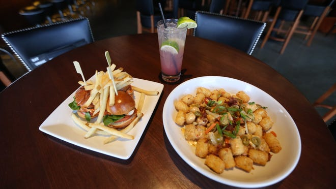 The chicken parm sliders, loaded tots and a watermelon fizz at Bar Louie on Tuesday, April 14, 2015 in West Des Moines.