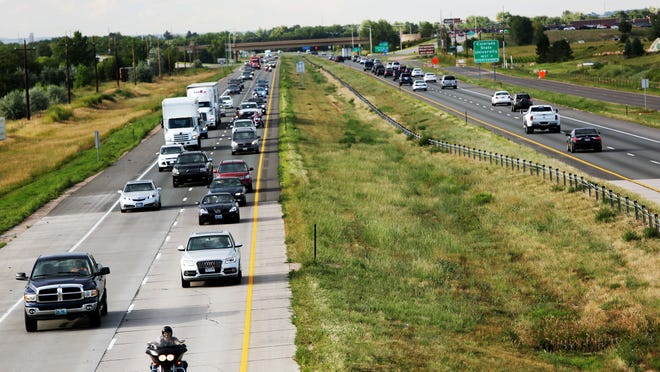 Traffic lines up on Interstate 25 on Friday. Sen. Michael Bennet has introduced a bill intended to create funding for transportation infrastructure that could help the cause of widening I-25.