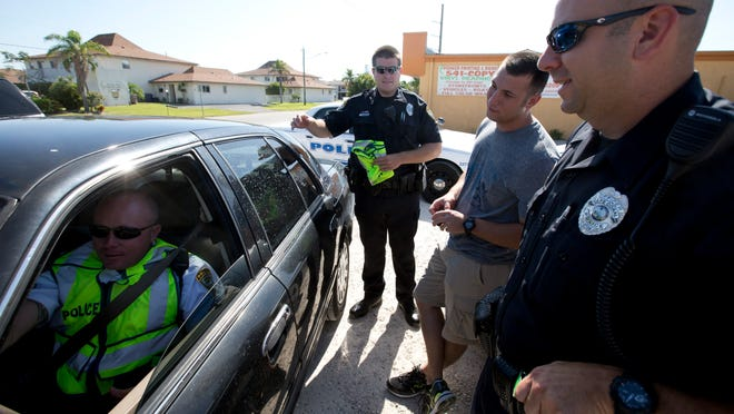 From left, Cape Coral police Cpl. Ray Schilke Jr., officer Keith Edinger, officer Charles Proudfit, and affic investigator Nicholas Green. Because of low pay, keeping officers has been a problem.