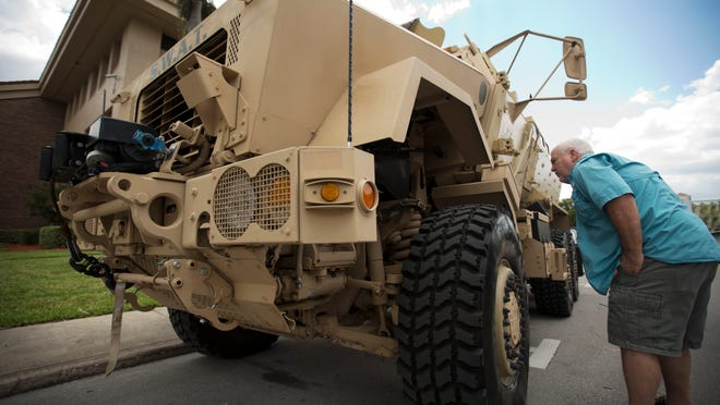 Mike Hofacker of Fort Myers gets a close up view of Fort Myers Police Department's new armored vehicle.