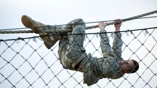 U.S. Army Staff Sgt. Jordan Stubblefield of Green Bay negotiates the obstacle course during a Best Warrior Competition on Feb. 6 at Camp Bullis, Texas.