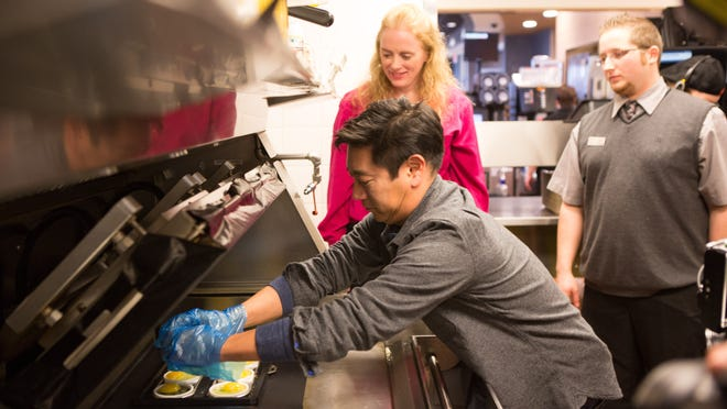"""Grant Imahara, the former host of Discovery Channel's show """"Myth Busters"""" cracks an egg in the kitchen at McDonald's in Grand Ledge during the filming of a """"Our Food, Your Questions"""" Webisode. The four-minute video debuted Monday on the company's Web site, Facebook page and YouTube channel."""