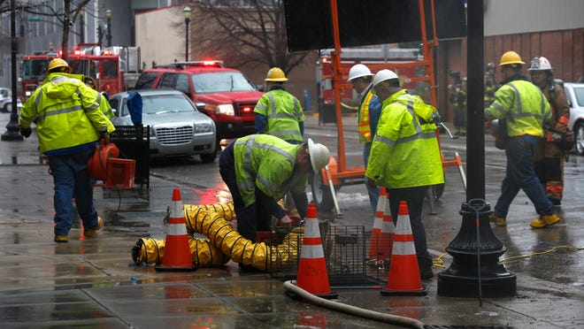 Workers vented smoke from an opening in the sidewalk after an underground explosion at 4th and Liberty streets this afternoon. March 10, 2015.