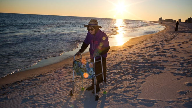 Ruby Holt, a 100-year-old Tennessee native, reflects as she sees the ocean for the first time in her life Wednesday, Nov. 19, 2014, in Orange Beach, Ala. The Brookdale Senior Living and Wish of a Lifetime organizations both provided Holt a wish of her choice.
