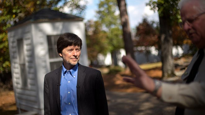 In this Nov. 2, 2013, file photo, documentary filmmaker Ken Burns walks through the entrance of the Georgia home used by former President Franklin D. Roosevelt during a tour by site manager Robin Glass in Warm Springs, Ga. Burns details the connections between two distantly related American presidents in his new documentary series. The 14-hour series unfolds over seven days on PBS, starting Sunday.