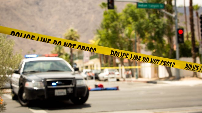 Police tape marks the scene of a fatal hit-and-run crash Friday, July 4, 2014 on Indian Canyon Drive.