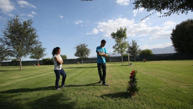 Maria Teresa Mendez and her son Sergio Ceballos visit the grave of son and brother Juan Ceballos who was murdered on July 13, 2014 for allegedly being homosexual.