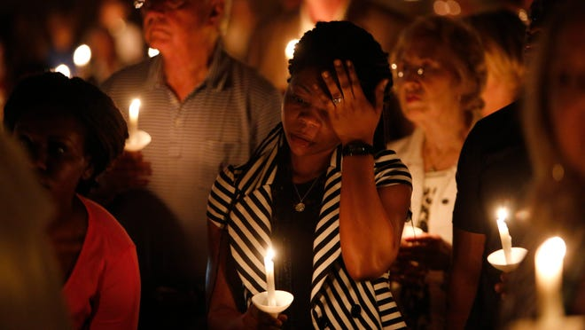Mamie Mangoe, a friend of the Duncan family, wipes a tear away during a memorial service for Ebola victim Thomas Eric Duncan at Wilshire Baptist Church in Dallas.