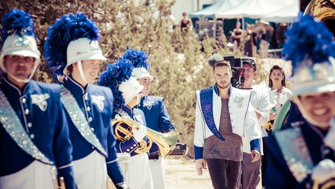 Provided photo A photo released by One Direction shows the members of the Shadow Hills High School band will be featured in the music video.
