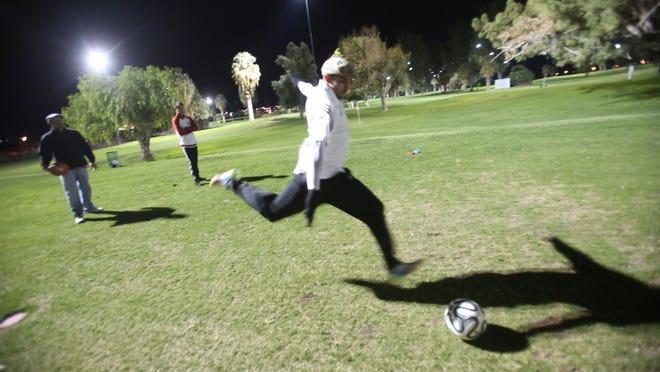 Sharif Khatib kicks the ball during a game of footgolf at Indio Golf Course.