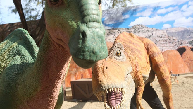 """The Living Desert unveiled its """"Zoorassic Park"""" show at the Tennity Amphitheatre on Thursday. The production includes life-like mechanical dinosaur costumes created by the Chiodo brothers, a Hollywood creature-making team whose work has been featured in such films as """"Critters,"""" """"Elf,"""" """"Dinner For Schmucks"""" and """"Gremlins."""""""