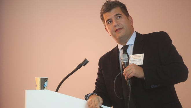 Dr. Maurice Garcia, an urologic surgeon speaks at a transgender symposium at the Saguaro Hotel which was presented by the Eisenhower Medical Center on January 10, 2015.