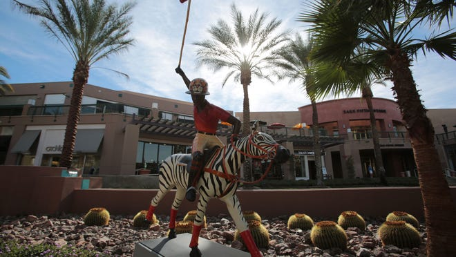 """""""Polo Africa,"""" by Joanne Sullam, is on display at the Gardens on El Paseo in Palm Desert. The statue is one of many being sold at an auction to benefit the Barbara Sinatra Center for Abused Children."""