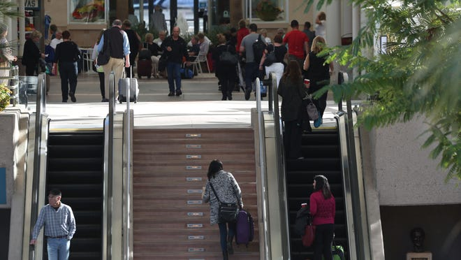 The airport was busy Wednesday, as travelers sought to catch their flights.