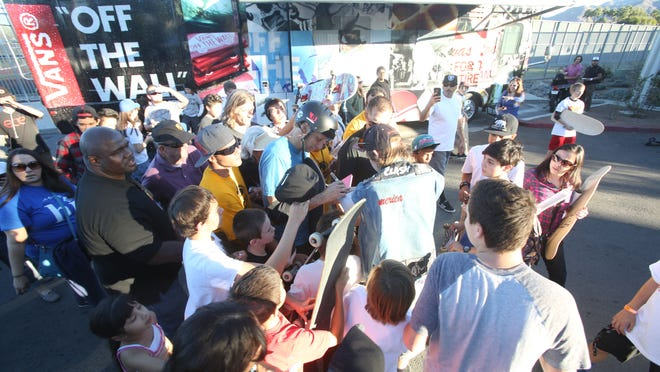 Fans gather around skateboarder Tony Hawk at the El Gato Skateboard Classic on Saturday at the Palm Springs Skate Park.