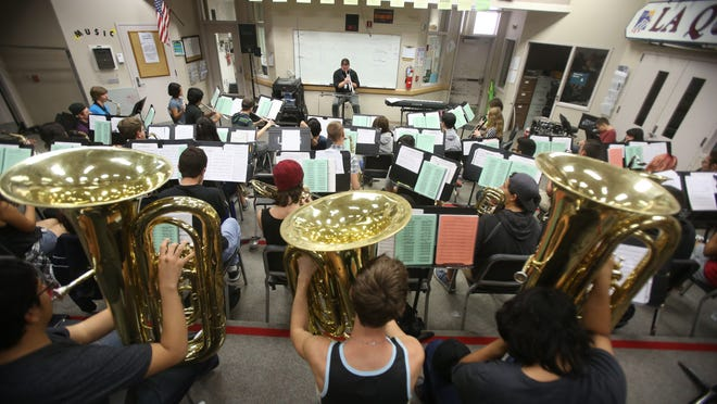 La Quinta High School's wind symphony rehearses for their show at Carnegie Hall later this year. The group will have an opportunity to perform three songs at the historic venue.
