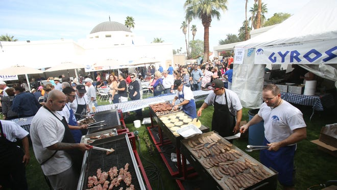 Food is prepared at the annual Greek Festival held at St. George Greek Orthodox Church in Palm Desert on Saturday.
