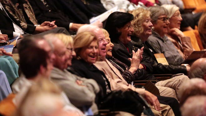 The audience laughs at one of Dick Cavett's stories Tuesday.
