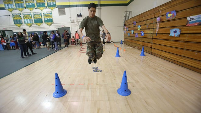 """Coachella Valley High School student Jonathan Agular goes through an obstacle course during a """"health fair"""" held at the high school."""