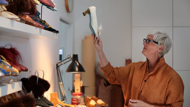 Palm Springs shoe designer Debra Hovel shows off a shoe she made for a wedding. Hovel leaves messages of luck inside the heels of the bridal shoes she makes.