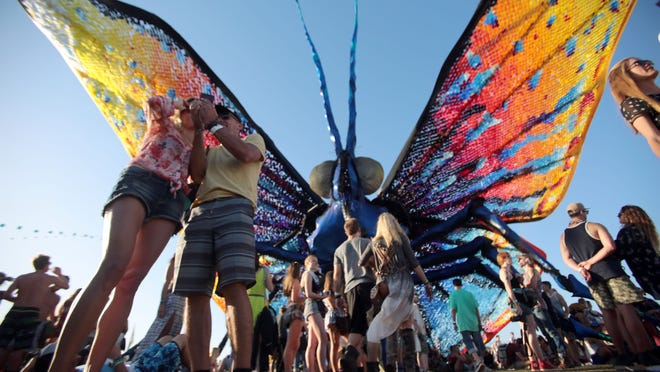 Music lovers soak up the colorful sights and sounds Sunday at Coachella Music Festival.