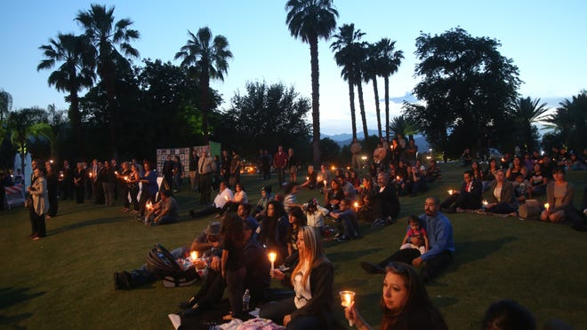Member of the community attend a vigil at Palm Desert Civic Center on Tuesday. The vigil is held annually in honor of National Crime Victims' Rights Week.